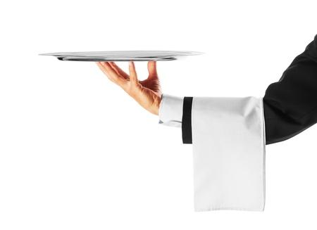Eine Hand hält ein silbernes Tablett