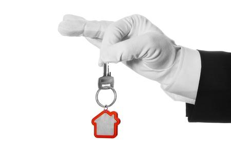 Hausschlüssel in der Hand butler Standard-Bild