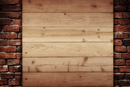 Wooden plank on a wall of bricks photo