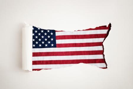 reveals: Torn paper reveals the American flag