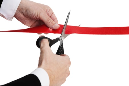 reformer: Red ribbon cutting with a pair of scissors