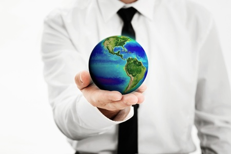 Man holding a earth globe in his hand Stock Photo - 17643793