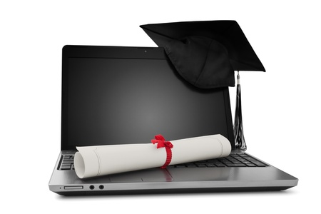computer training: Diploma and laptop Stock Photo