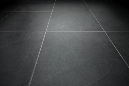tile flooring: Black tile flooring close up as background