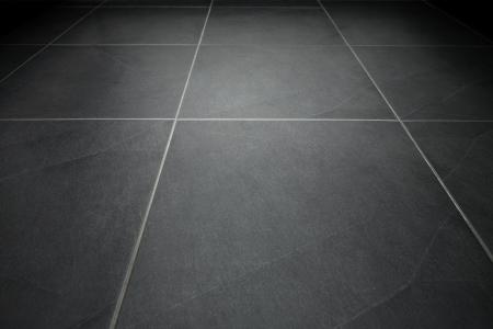 tile flooring: Black tile flooring close up as background