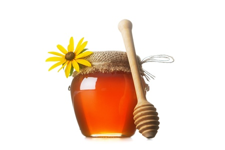 Honey with wood stick photo