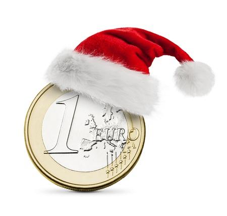 christmas profits: Santa hat on coin one euro