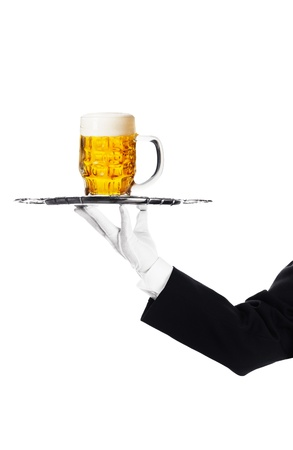 Waiter holding a tray with a beer glass Stock Photo