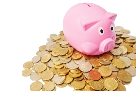 Pink piggy bank with pile coins photo