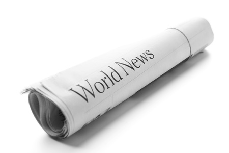 medium close up: World News -Roll of newspapers Stock Photo