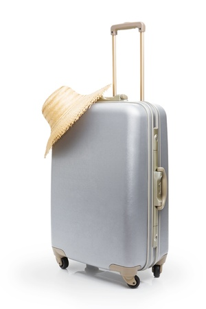 luggage pieces: Summer time -Travel bag and straw hat Stock Photo