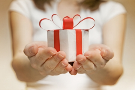 Time gifts - gift box in hand girls Stock Photo - 18247938