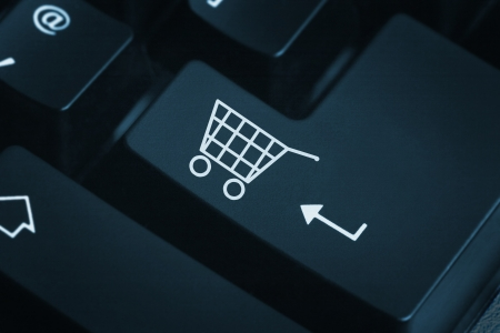 e store: Online shop -The button for purchases on the keyboard Stock Photo