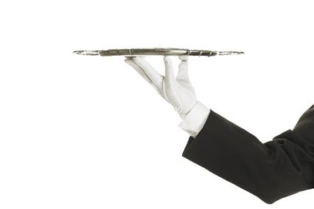 Eine Hand hält ein silbernes Tablett Standard-Bild - 18640537