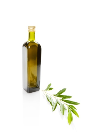 Olive oil bottle and olive branch photo