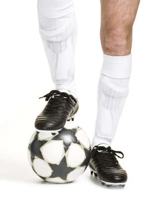 white socks: Soccer player with ball