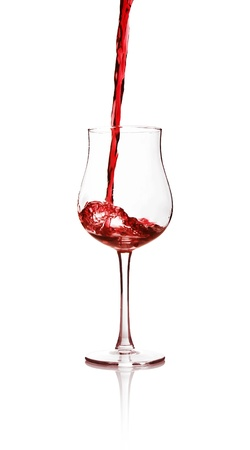 agitated: Red wine poured into a glass Stock Photo