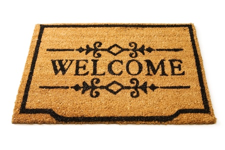 welcome home: Welcome mat Stock Photo