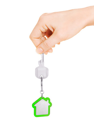 downpayment: Hand holding key of house Stock Photo