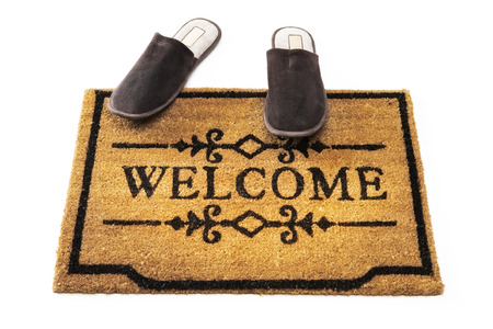 straw mat: Welcome mat and slippers Stock Photo