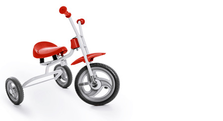 白い背景の上の子供の三輪車
