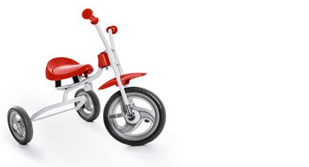 juguetes antiguos: Los niños de tres ruedas en el fondo blanco