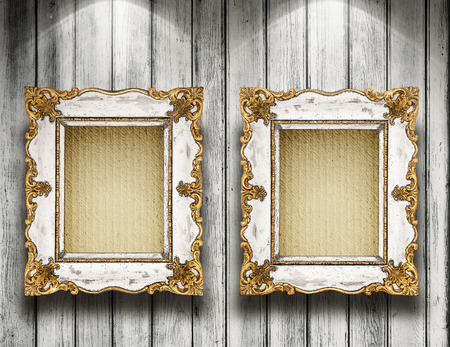 Two antique frame on wooden gallery wall photo