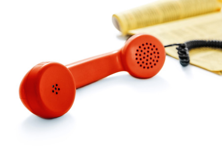 Red old phone and phone directory -Clipping Path photo