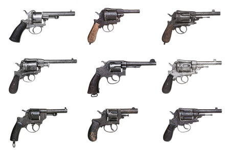 gun barrel: Collection of antique revolvers isolated on white Stock Photo