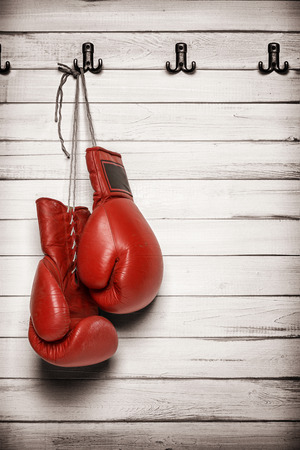 Boxing gloves hanging on wooden wall -including clipping path 스톡 콘텐츠