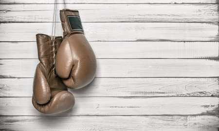 boxing training: Boxing gloves hanging on wooden wall -including clipping path Stock Photo