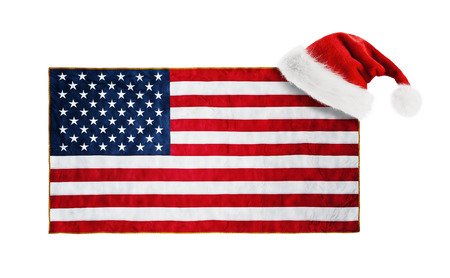 Santa Claus hat hung on the US flag photo