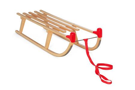 trineo: Trineo de madera sobre fondo blanco
