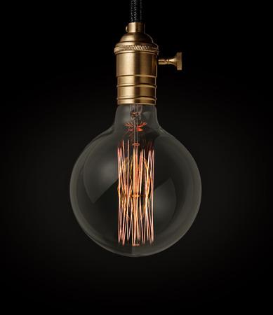 thomas: Edison light bulb on black background Stock Photo
