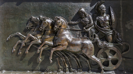 chariot: A panel on the front of the Achillion Palace on the island of Corfu Greece. This panel is a replica of one originally found on the Parthenon in Athens Greece