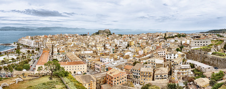 corfu: Panoramic view of Corfu city with the Old Fortress on the background as seen from the New Fortress