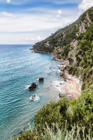 naturist: Mirtiotissa beach on Corfu island Greece Stock Photo