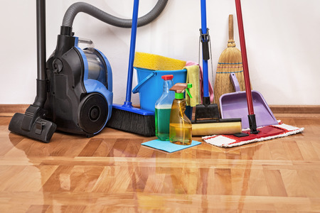 House cleaning -Cleaning accessories on floor room Foto de archivo