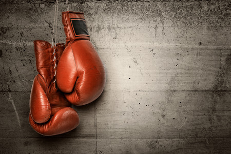 boxing sport: Boxing gloves hanging on concrete wall -including clipping path