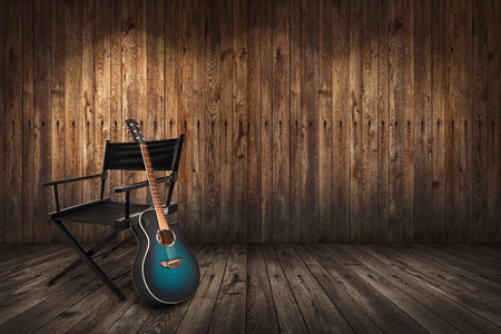 wood floor background: Guitar and chair on the floor and background of wooden planks
