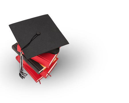 rewarded: Graduation cap on top of a stack of books