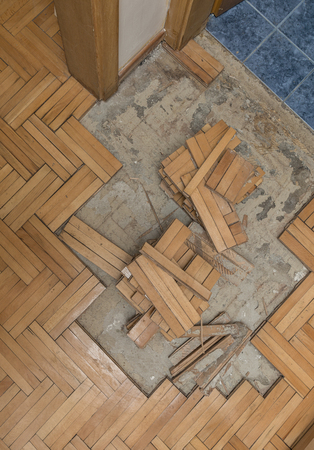 laminate: Ruined flooring from moisture and water from bathroom
