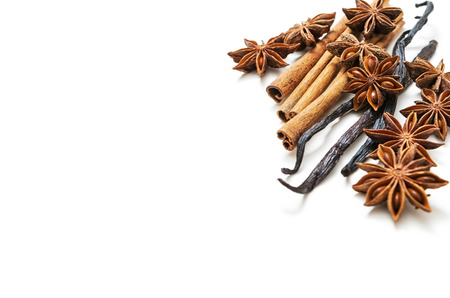 anisetree: Star anise, cinnamon and vanilla pods on white background