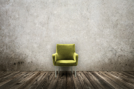 grunge room: Green vintage chair in grunge room Stock Photo