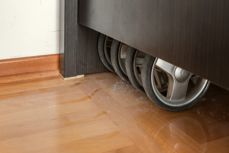 parquet floor layer: Dust layers on the floor under bed