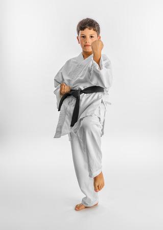 karate boy: Boy in white kimono during training karate kata exercises