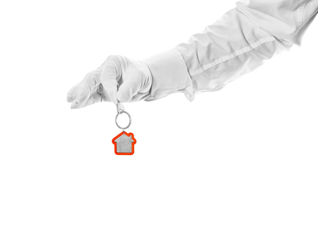 hypothec: House key in hand butler isolated on white Stock Photo