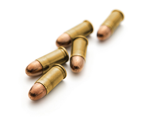 A group of 9mm bullets for a gun on white background