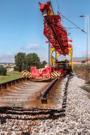 railway track: Heavy machinery repairs rail lines