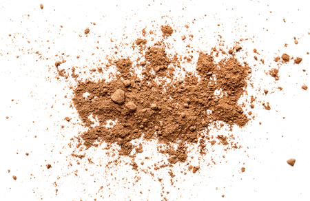 Cocoa powder on white background Imagens